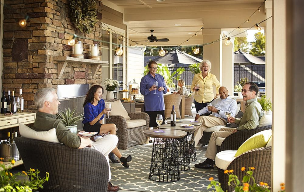 adults-socializing-on-outdoor-patio