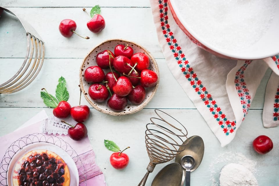 red cherries in a bowl on a table