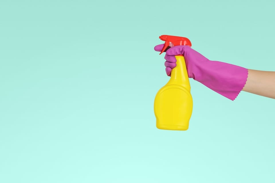 gloved-hand-holding-spray-bottle