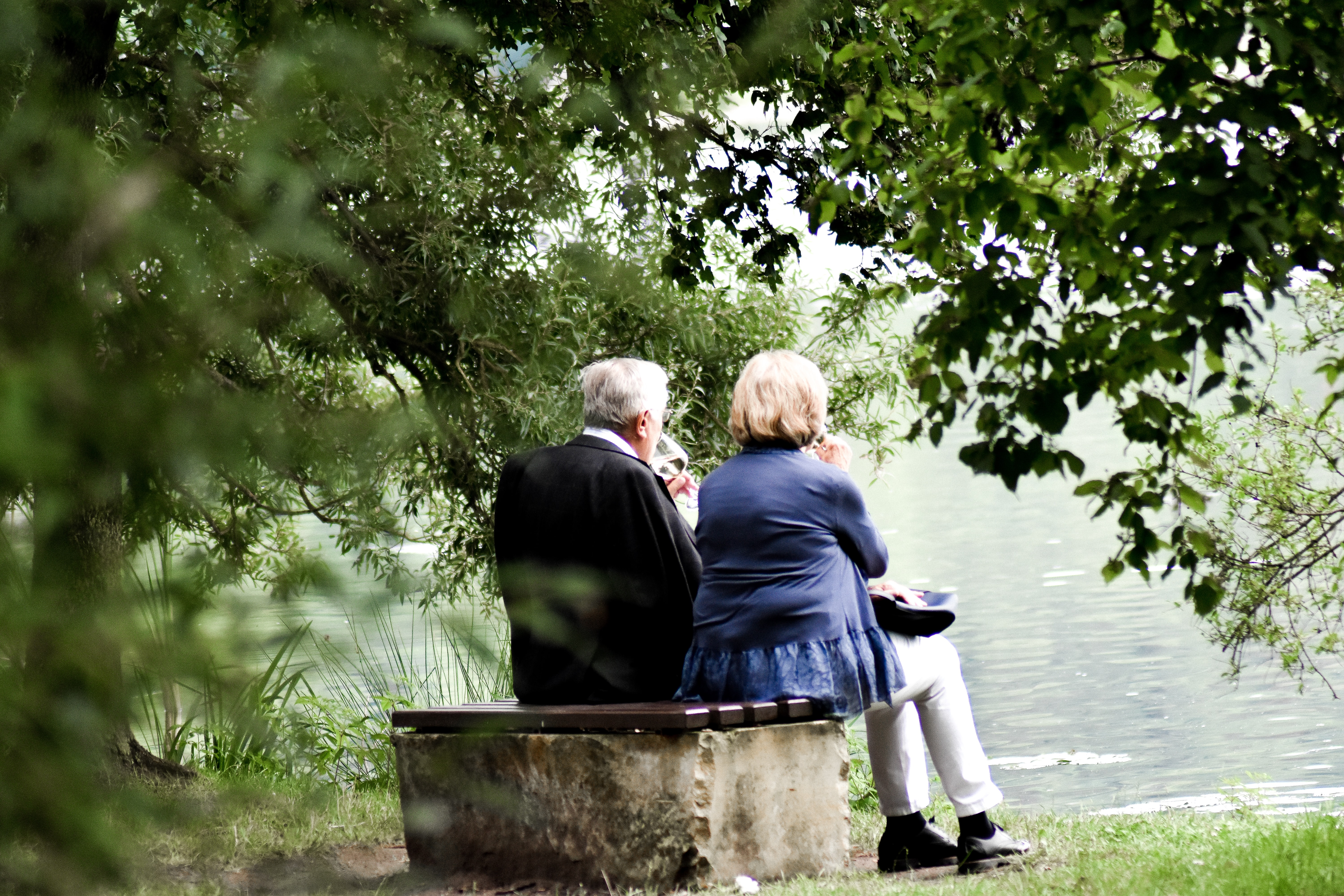 older-couple-sitting-by-pond